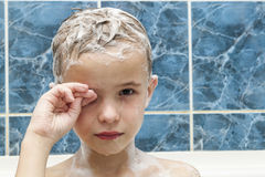 Adorable baby boy with shampoo soap suds on hair taking bath. Cl Stock Image