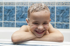 Adorable baby boy with shampoo soap suds on hair taking bath. Cl Royalty Free Stock Photography