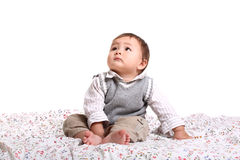 Adorable baby boy sitting in bed stock photo