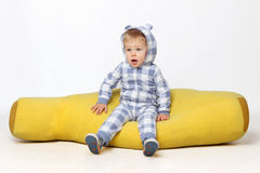 Adorable baby boy sitting. Stock Images