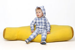 Adorable baby boy sitting. Stock Photo