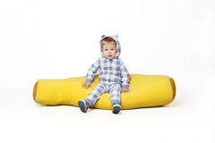 Adorable baby boy sitting. Royalty Free Stock Images