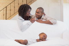 Adorable baby boy sleeping while being watched by parents Stock Photo