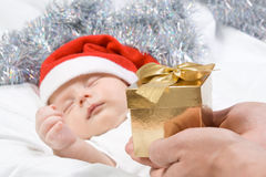 Adorable baby boy sleeping in christmas hat Stock Photos