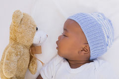 Adorable baby boy sleeping peacefully with teddy Royalty Free Stock Image