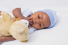 Adorable baby boy sleeping peacefully with teddy Royalty Free Stock Images