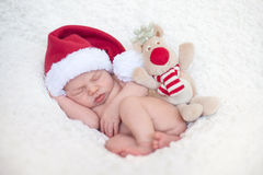 Adorable baby boy, sleeping. With santa hat Stock Images