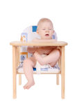Adorable baby boy sneeze his chair Royalty Free Stock Photography