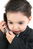Adorable Baby Boy in Suit on Cellphone royalty free stock image