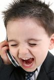 Adorable Baby Boy In Suit Yelling Into Cellphone stock photo