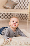 Adorable baby boy in sunny bedroom. Newborn child relaxing. Family morning at home. New born kid during tummy time. Stock Image