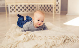 Adorable baby boy in sunny bedroom. Newborn child relaxing. Nursery for young children.Family morning at home. Little Royalty Free Stock Image