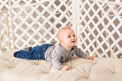 Adorable baby boy in sunny bedroom. Newborn child relaxing. Nursery for young children.Family morning at home. Little Royalty Free Stock Photography