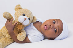 Adorable baby boy with teddy stock photography