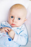 Adorable baby boy in white sunny bedroom Royalty Free Stock Photo