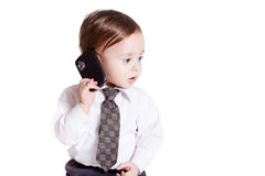 Adorable baby businessman with phone. Isolated Royalty Free Stock Photos