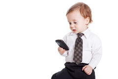 Adorable baby businessman with phone. Isolated Stock Photography