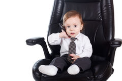 Adorable baby businessman with phone. Isolated Stock Photos