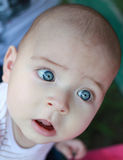 Adorable baby, caucasian, blonde and with stunning blue eyes. Perfect blue eyes. Stock Photos