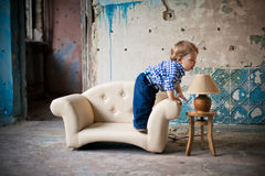 Adorable baby in the chair Royalty Free Stock Image