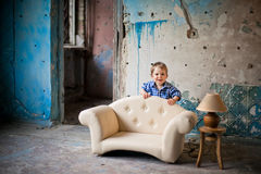 Adorable baby in the chair Stock Photos