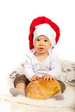 Adorable baby chef with bread Stock Photos