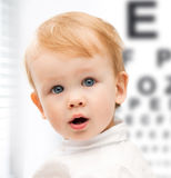 Adorable baby child with eyesight testing board. Medicine, health and vision concept - adorable baby child with eyesight testing board stock images