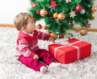 Adorable Baby With Christmas present Royalty Free Stock Photos