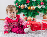 Adorable Baby With Christmas present Stock Photo