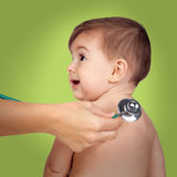Adorable baby with doctor for a pediatric examination Stock Images