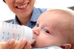 Adorable baby drinking a bottle Royalty Free Stock Photo