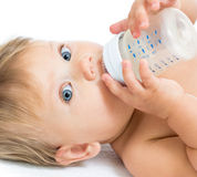Adorable baby drinking from bottle Stock Photos