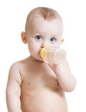 Adorable baby drinking milk from bottle Stock Photos
