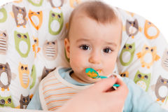 Adorable baby eating Royalty Free Stock Images