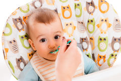 Adorable baby eating Stock Photos