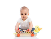 Adorable baby enjoy and playing percussion Royalty Free Stock Images