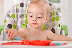 Adorable baby enjoy to eat watermelon Royalty Free Stock Photos