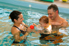 Adorable baby enjoying swimming in a pool with his mother. Ponte Tresa, Switzerland - 18 october 2007: Adorable baby enjoying swimming in a pool with his mother stock photography