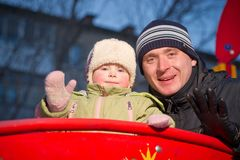 Adorable baby and father look from bridge Royalty Free Stock Images