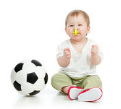Adorable baby football player with ball Stock Images