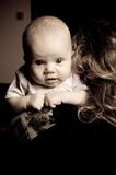 Adorable baby girl. Looking over shoulder of person who is holding her Stock Photography