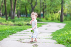 Adorable baby girl in beautiful summer garden Stock Photos