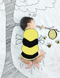 Adorable baby girl is bee flying for honey. Stock Photos