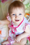 Adorable baby girl with blue eyes and a smile Royalty Free Stock Photography