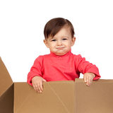 Adorable baby girl in a box Stock Photography