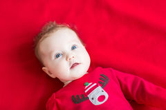 Adorable baby girl in a Christmas reindeer shirt Stock Images
