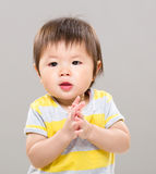 Adorable baby girl clapping hand Royalty Free Stock Image