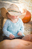 Adorable Baby Girl with Cowboy Hat at the Pumpkin Patch Royalty Free Stock Photography