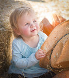 Adorable Baby Girl with Cowboy Hat at the Pumpkin Patch Royalty Free Stock Photos