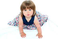 Adorable baby girl crawling Stock Photos